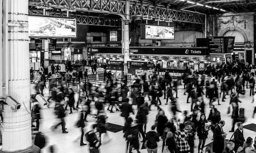 grayscale photography of people walking in train station 735795